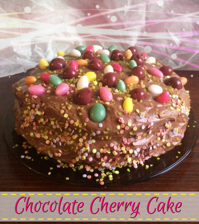 Chocolate Cherry Cake - Anna Can Do It! Rich, moist and dense chocolate cake with cherry and vanilla cream filling layers and creamy, fluffy chocolate ganache frosting.